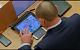 Единоросс на заседании свердловского парламента играл на телефоне по-македонски - с двух рук