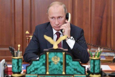 Кремль: Путин обсудил с Меркель и Макроном «провальную политику» Порошенко
